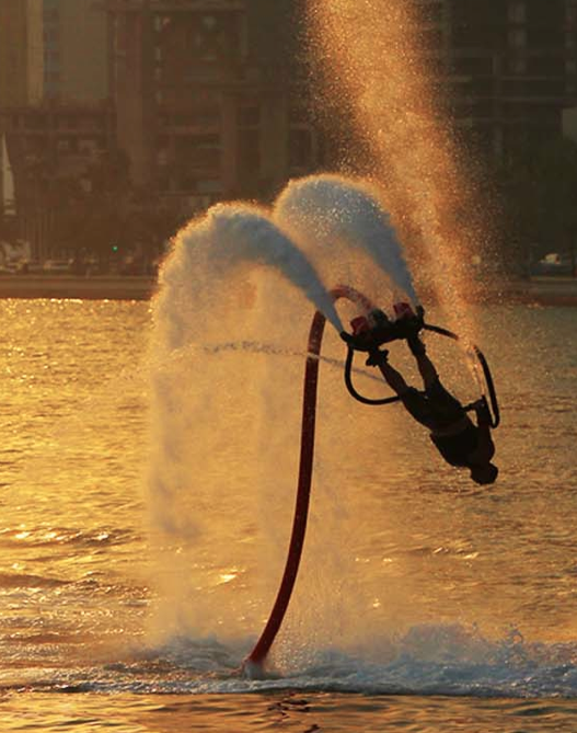 Somersaulting Flyboard Stunt performer