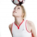 Woman ball balancing on head