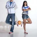 Male and female football freestylers