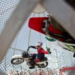 Extreme globe of death motorbike stunt show