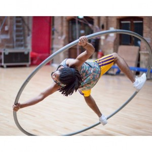 Masculine cyr wheel performer