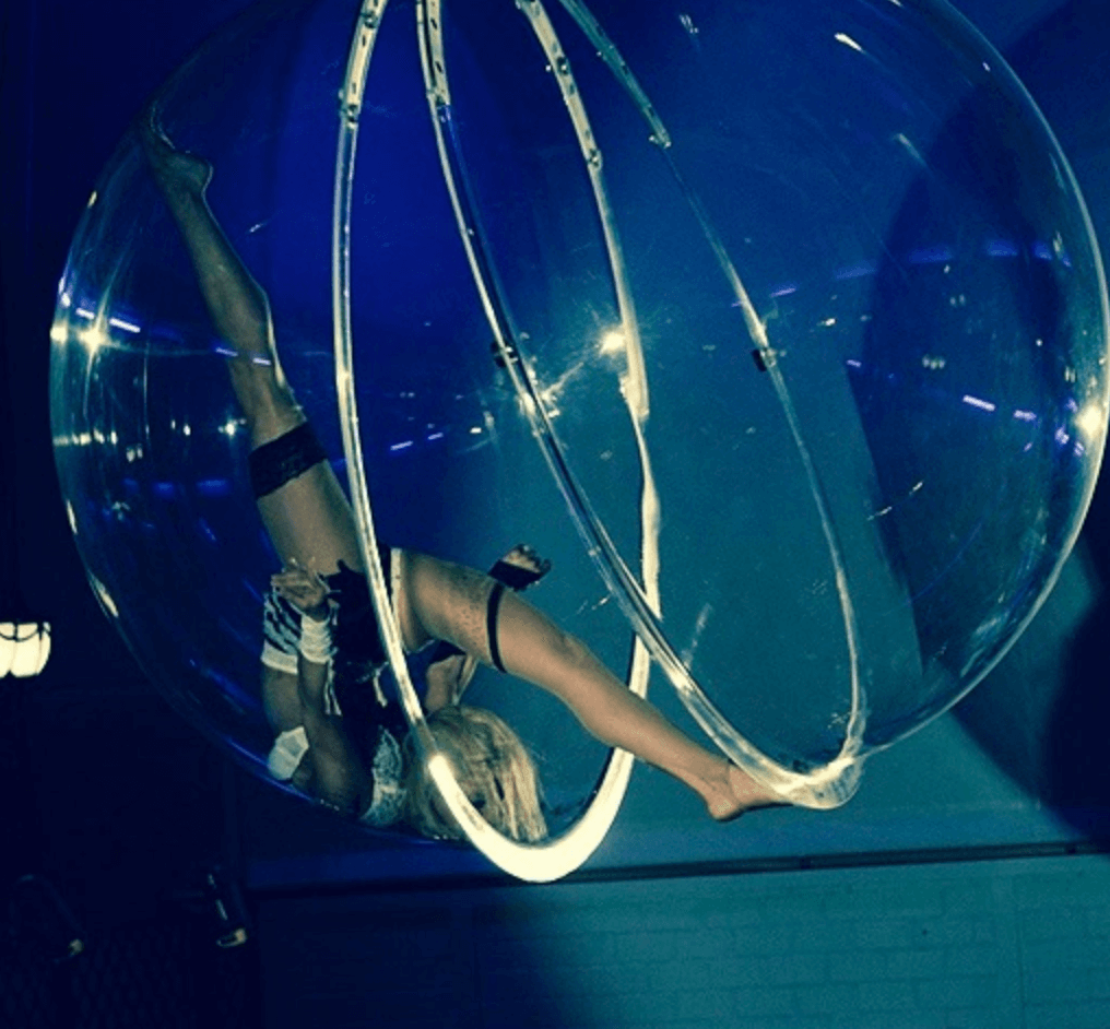 SUspended Glass Ball Acrobat