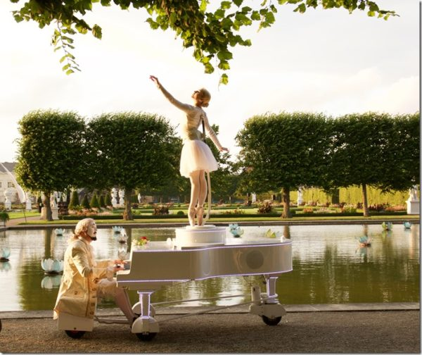 Performing ballerina on riverbank